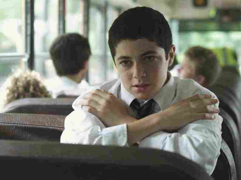Andy (Dylan Hartigan) must convince a pious fellow altar boy not to give away the details of their afternoons playing hooky.