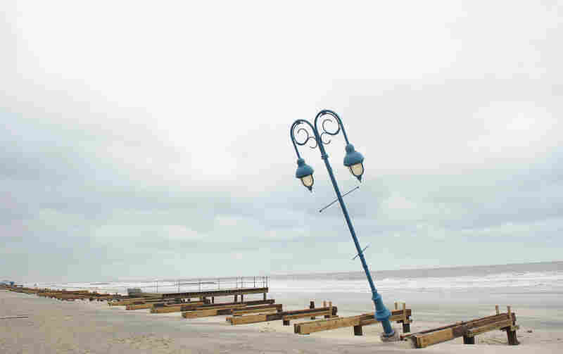 What remains of the 1.2-mile boardwalk sits on the beach on Oct. 30 in Belmar, N.J.