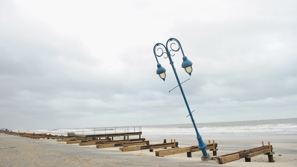 What remains of the 1.2-mile boardwalk sits on the beach on Oct. 30 in Belmar, N.J. (Getty Images)