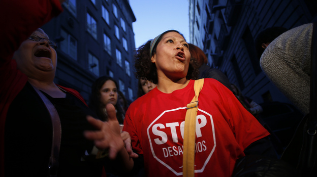 Olga Veloso protests banking giant Bankia last month in Madrid. Veloso and her neighbors have twice blocked bailiffs from evicting her from her apartment after she lost her job and stopped paying the mortgage. (Reuters/Landov)