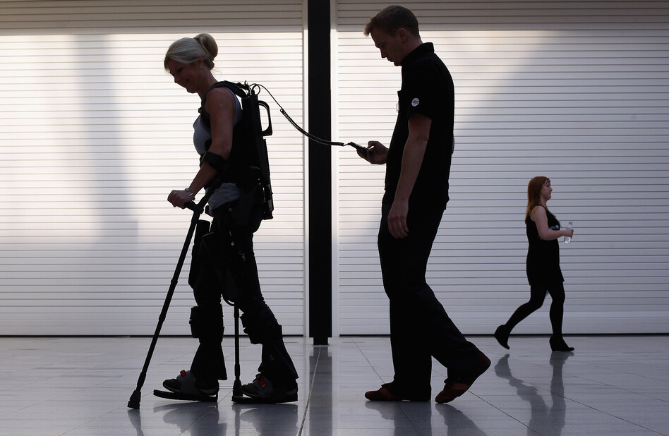 Paralyzed from the waist down, Amanda Boxtel walks with the aid of a bionic exoskeleton in London in 2011. Users learn to walk in the Ekso Bionics device with rehabilitation technicians controlling their steps before walking on their own. (Getty Images)