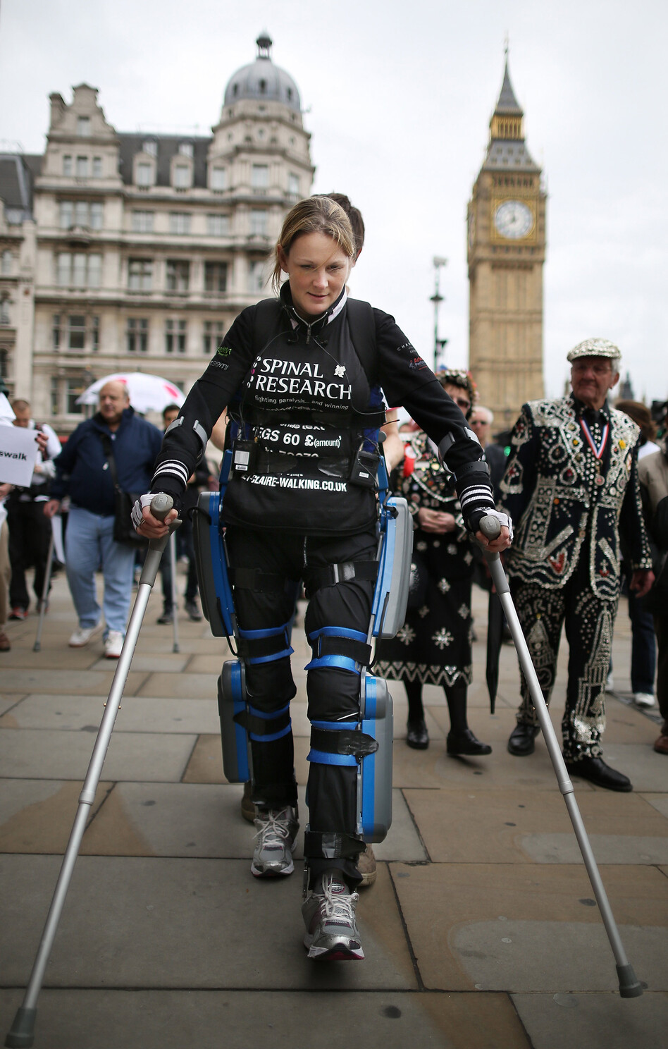 Claire Lomas, a paraplegic, walks the last mile of the London Marathon in May 2012. Starting out with 36,000 other runners, she averaged two miles a day with the help of a bionic ReWalk suit by Argo Medical Technologies. (Getty Images)