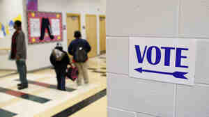 A sign directs voters to the gymnasium at the Martin Luther King elementary school in Milwaukee, Wisconsin, on November 6, 2012.