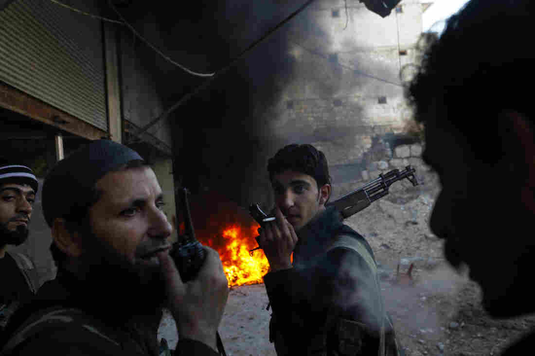 Syrian rebels take position during clashes with regime forces in Al-Amariya district of the northern city of Aleppo on Tuesday.
