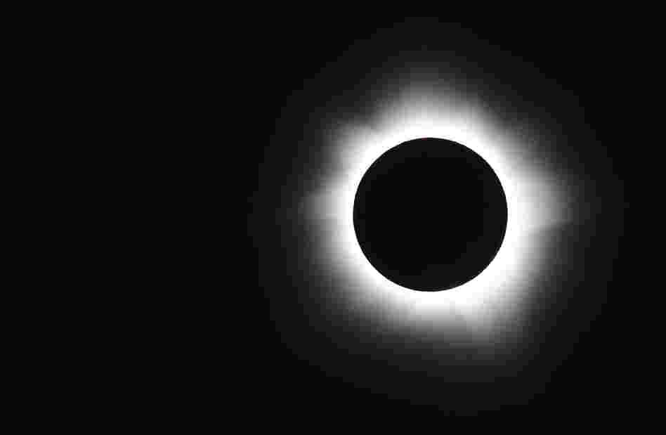 Totality is seen during the solar eclipse at Palm Cove, Australia.