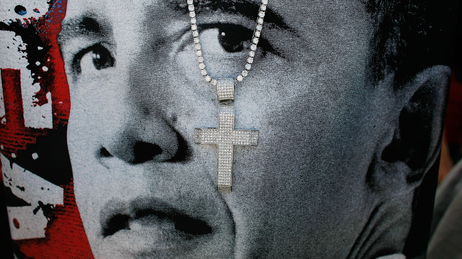 A cross hangs in front of a T-shirt printed with Barack Obama's face at a 2008 campaign event in Las Vegas. (Getty Images)