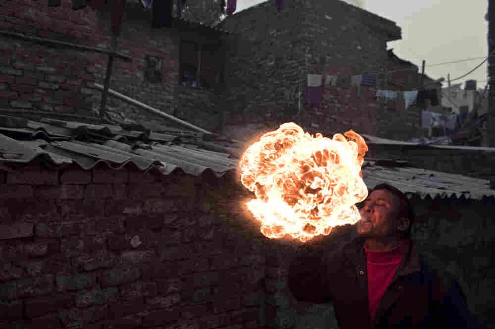A fire-breather in the Kathputli Colony, New Delhi, India.