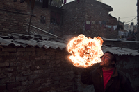 A fire-breather in the Kathputli Colony, New Delhi, India.