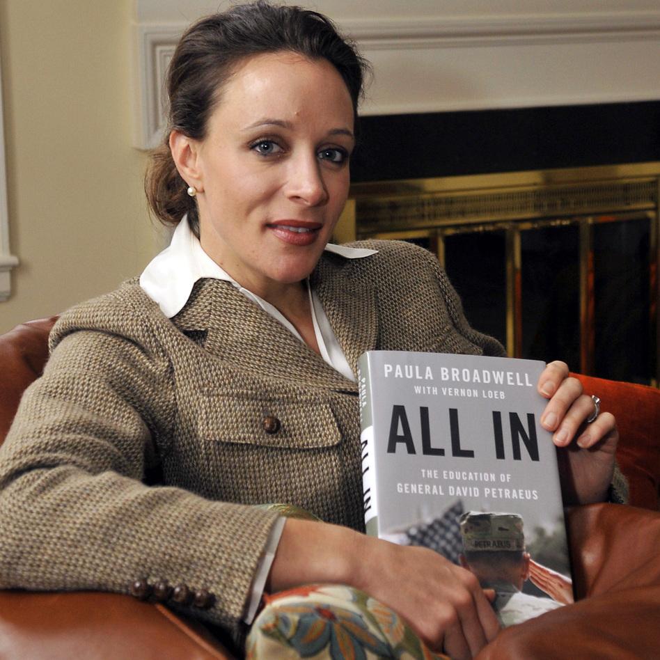 Paula Broadwell, with her book about David Petraeus. (MCT /Landov)