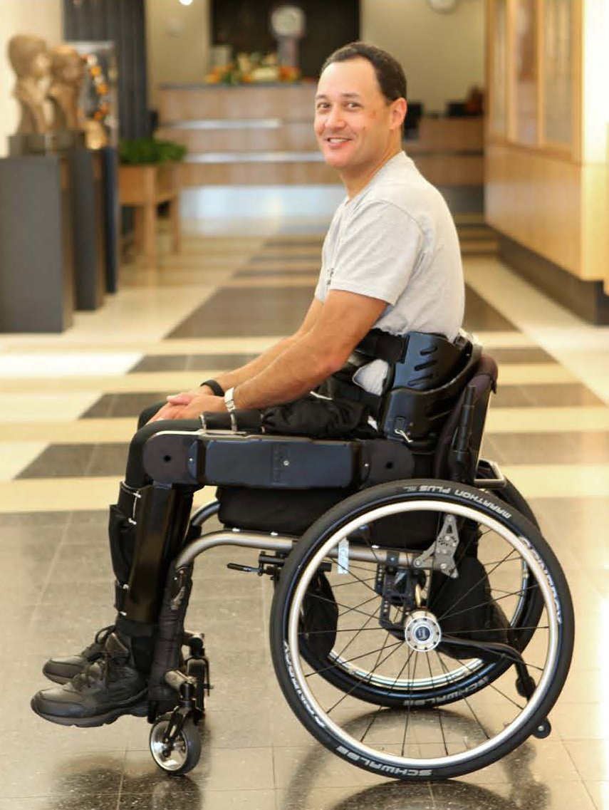 A patient wears the Vanderbilt device in his wheelchair. The Vanderbilt researchers say that it has some advantages over others. It's lighter, breaks into three parts and fits in a small wheelchair.