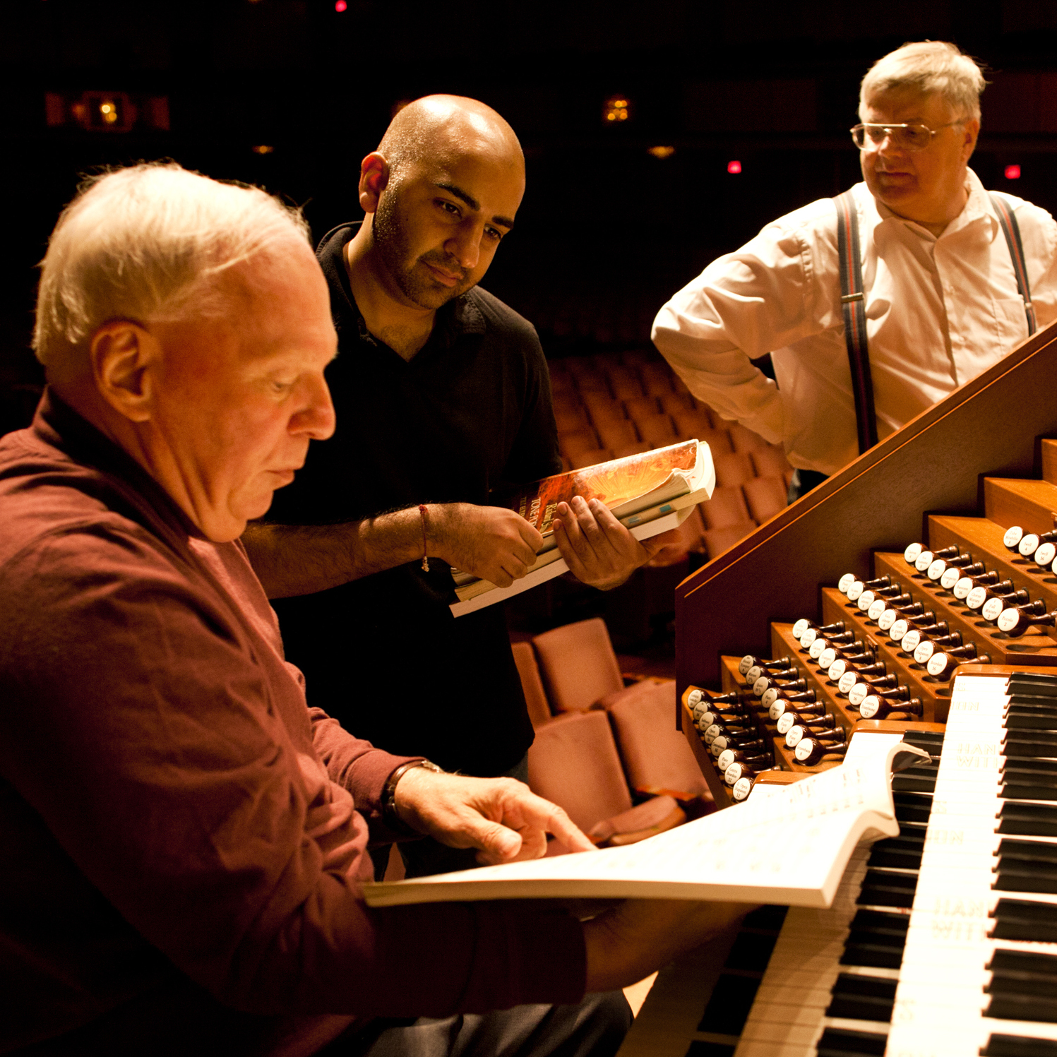 After years of waiting, the Kennedy Center has a new symphonic organ replacing its old organ installed in 1972. The $2 million project will culminate in the organ's debut on Nov. 27. William Neil (left), the National Symphony Orchestra organist, speaks with NSO Assistant Conductor Ankush Kumar Bahl (center) during the organ's test with the orchestra on Oct. 18.