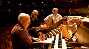 After years of waiting, the Kennedy Center has a new symphonic organ replacing its old Filene organ. The $2 million project will culminate in the organ's debut on Nov. 27. William Neil (left), the National Symphony Orchestra organist, speaks with NSO Assistant Conductor Ankush Kumar Bahl (center) during the organ's test with the orchestra on Oct. 18.