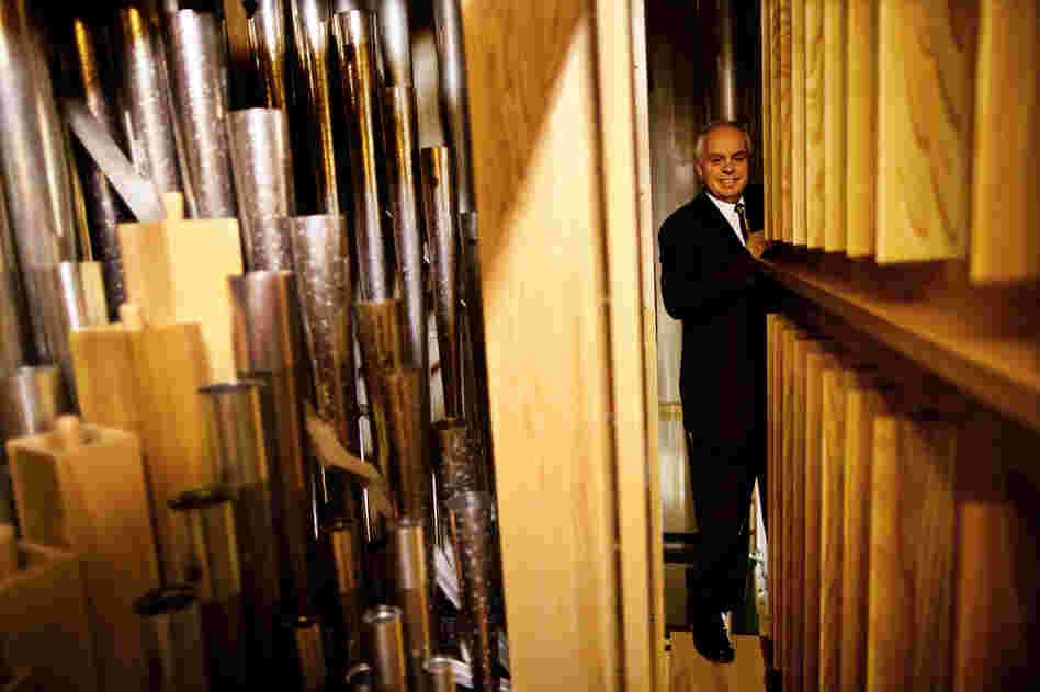 Rochette stands along a narrow passageway deep inside the organ chamber.
