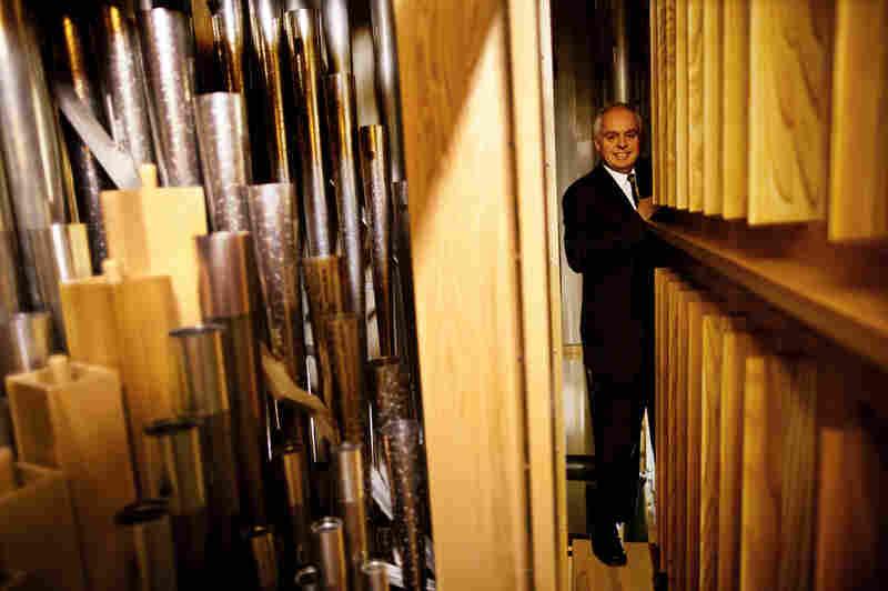 Rochette stands along a narrow passageway deep inside the organ chamber.