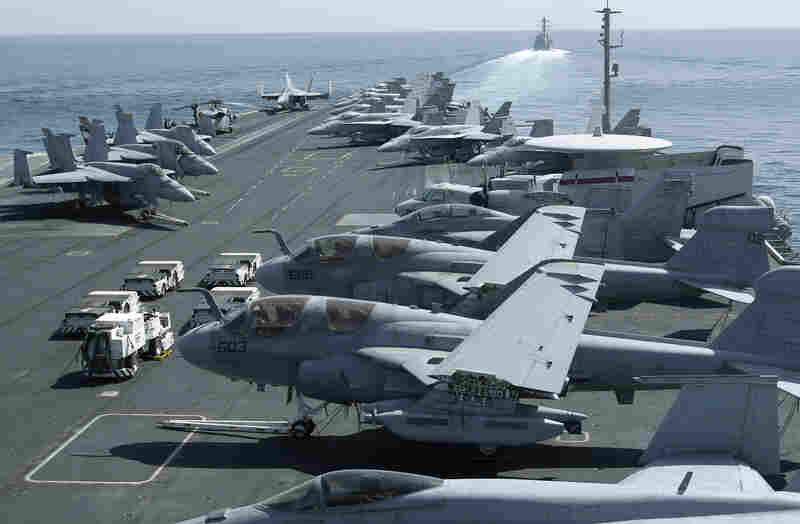 The U.S. maintains a strong naval presence in the Persian Gulf in order to safeguard key shipping lanes. Here, aircraft are parked on the flight deck of the USS Abraham Lincoln as a U.S. destroyer patrols the Arabian Sea in the Strait of Hormuz in February.