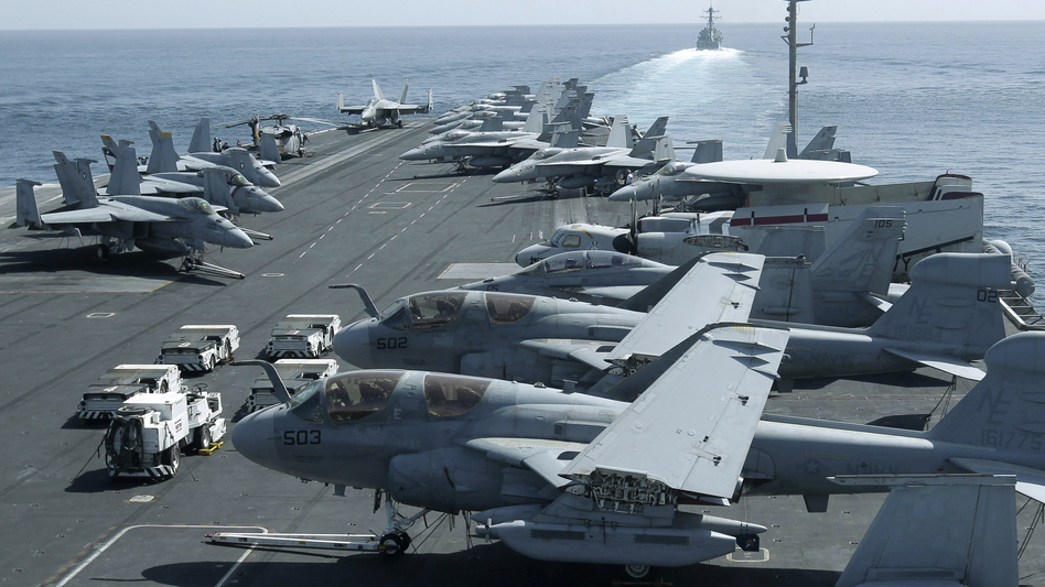 The U.S. maintains a strong naval presence in the Persian Gulf in order to safeguard key shipping lanes. Here, aircraft are parked on the flight deck of the USS Abraham Lincoln as a U.S. destroyer patrols the Arabian Sea in the Strait of Hormuz in February. (AP)