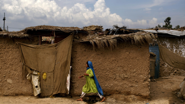 An Afghan refugee girl walks back to her home in a slum on the outskirts of the Pakistani capital, Islamabad, in August. She is one of an estimated 1.7 million mostly Afghan refugees in Pakistan. (AP)