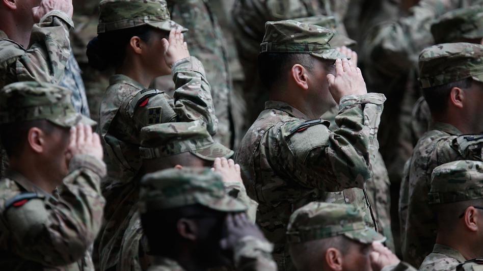 Soldiers of the U.S. Army V Corps conduct a color casing ceremony to mark the departure of V Corps headquarters from Europe on May 10, 2012, at the U.S. Army base in Wiesbaden, Germany. (Getty Images)
