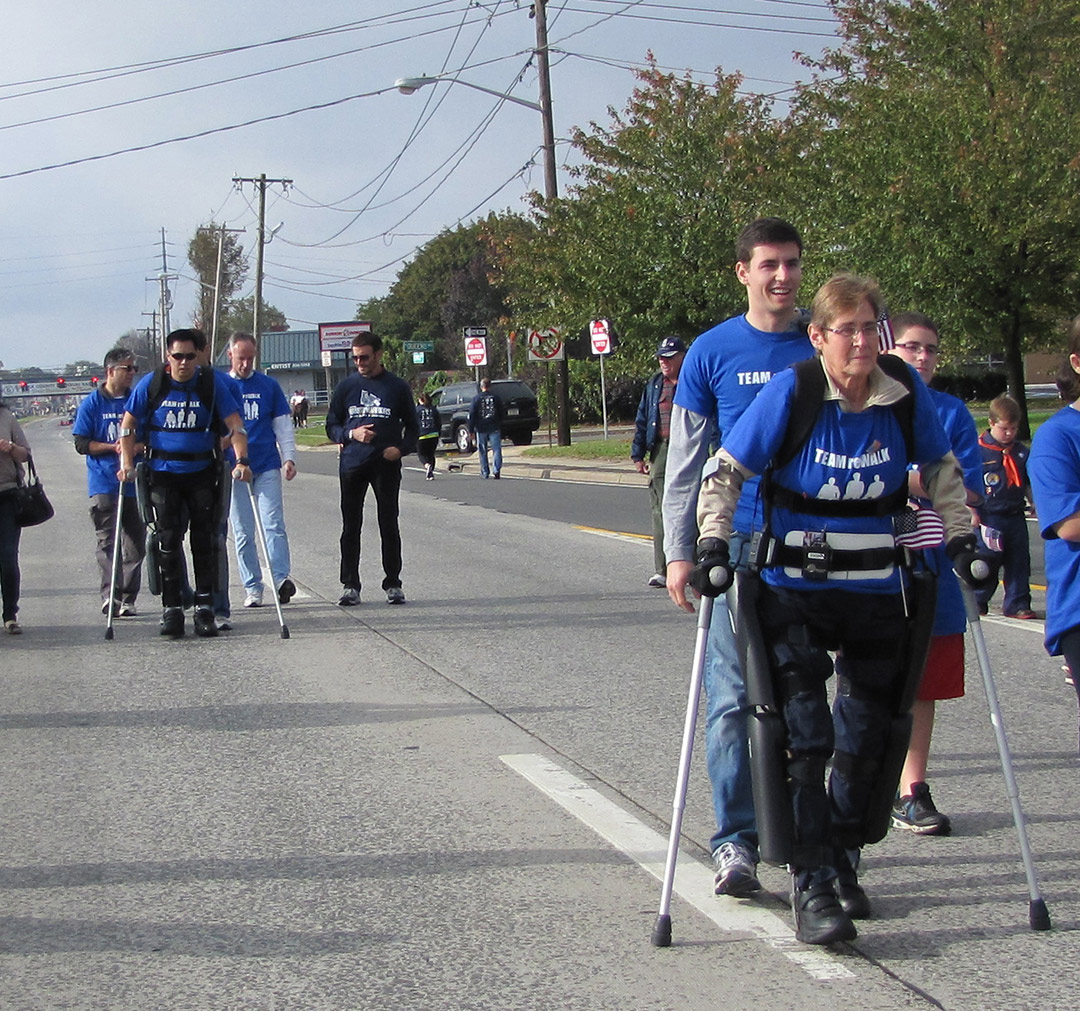 Robert Woo and Theresa Hannigan, both paraplegics, complete a one-mile walk in the ReWalk exoskeleton, developed by an Israeli company called Argo Medical Technologies. Argo's devices have been approved for personal use in Europe, but need FDA approval for sale in the U.S.