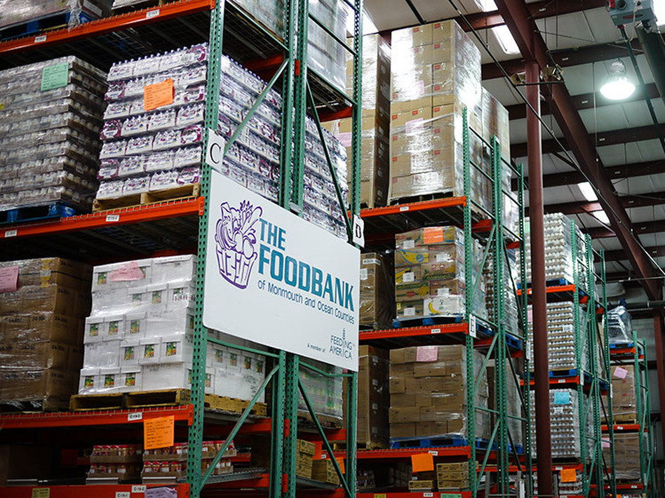 After Superstorm Sandy, the Food Bank of Monmouth and Ocean Counties in Neptune, N.J., is filled with water bottles, canned food and other goods. But these supplies are going out almost as fast as they come in.