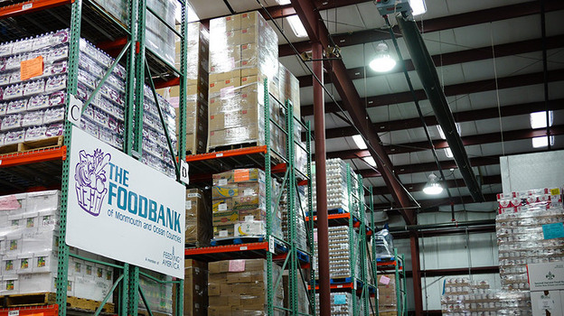 After Superstorm Sandy, the Food Bank of Monmouth and Ocean Counties in Neptune, N.J., is filled with water bottles, canned food and other goods. But these supplies are going out almost as fast as they come in. (NPR)