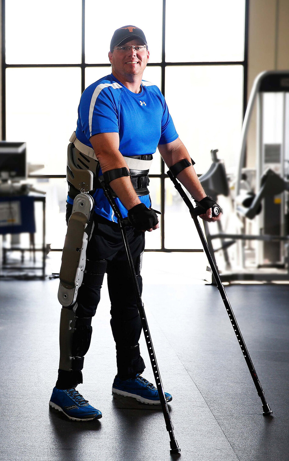 Brian Shaffer tests an exoskeleton developed by researchers at Vanderbilt University at a rehabilitation center in Franklin, Tenn. The exoskeleton locks around the legs and feet. To stand up, a paralyzed person simply leans forward. (Vanderbilt University)