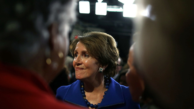 House Minority Leader Rep. Nancy Pelosi (D-Calif.) gathers around female House Democrats during a news conference on Wednesday. (Getty Images)