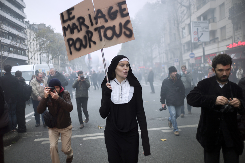 "A woman holds a sign ""marriage for all"" as she attends a demonstration called by unions in Paris. (AFP/Getty Images)"