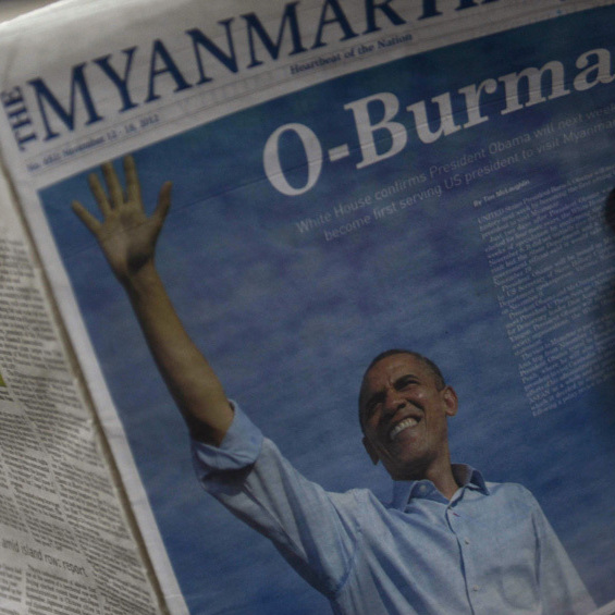 A girl reads a local newspaper with a picture of President Obama at a press house in Yangon, Myanmar, on Thursday, ahead of Obama's visit.