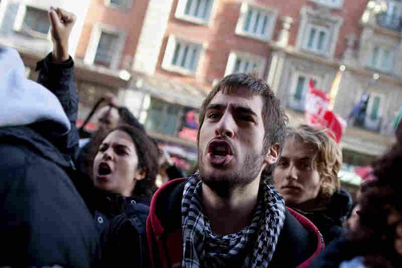 Demonstrators shout slogans into an open shop in Gran Via on Wednesday in Madrid, Spain.