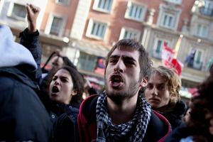 Demonstrators shout slogans into an open shop in Gran Via on Wednesday in Madrid, Spain.