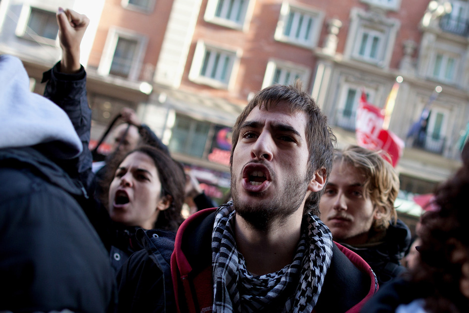 Demonstrators shout slogans into an open shop in Gran Via on Wednesday in Madrid, Spain. (Getty Images)