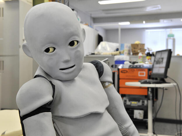 """Child-robot with Biomimetic Body"" (or CB2) at Osaka University in Japan in 2009, where the android was slowly developing social skills by interacting with humans and watching their facial expressions, mimicking a mother-baby relationship."