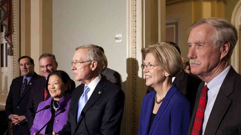 Sen.-elect Angus King of Maine (far right) joins newly elected Democratic senators and Senate Majority Leader Harry Reid on Capitol Hill on Wednesday. From left: Joe Donnelly of Indiana, Tim Kaine of Virginia, Mazie Hirono of Hawaii, Reid, and Elizabeth Warren of Massachusetts.