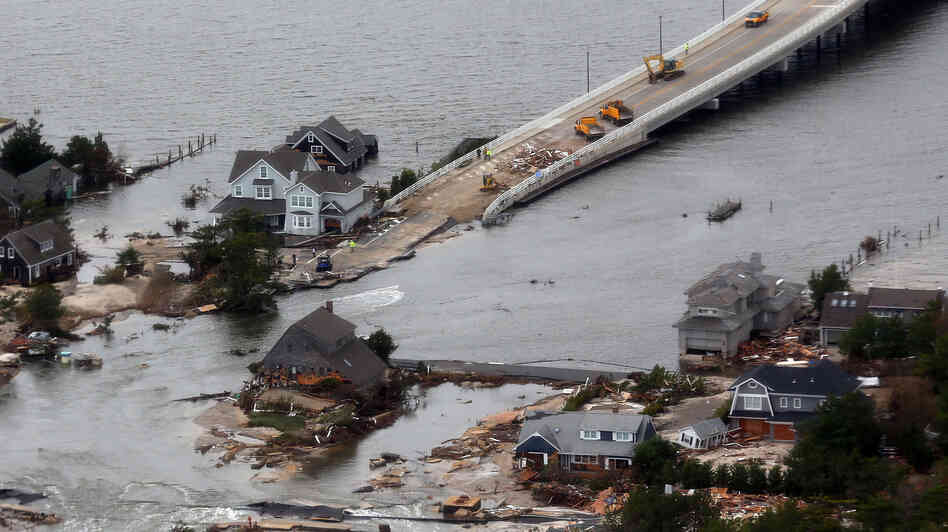 Sandy punched a hole in the barrier island that holds the affluent borough of Mantoloking, N.J., temporarily splitting the community in two. The st