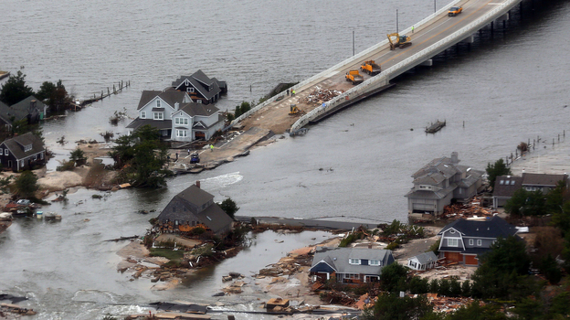 Sandy punched a hole in the barrier island that holds the affluent borough of Mantoloking, N.J., temporarily splitting the community in two. The storm also destroyed several multimillion-dollar homes and erased the island's protective system of dunes. (AP)