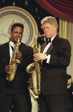 President Clinton plays the saxophone with an unidentified musician at the Arkansas ball on Inauguration Day, Jan. 20, 1993.