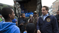 New York Gov. Andrew Cuomo meets Nov. 10 with residents of the Far Rockaways section of Queens, which was hit hard by Hurricane Sandy. Cuomo is seeking $30 billion in federal assistance to help rebuild his state at a time when Congress is already consumed with reducing the deficit.