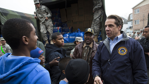 New York Gov. Andrew Cuomo meets Nov. 10 with residents of the Far Rockaways section of Queens, which was hit hard by Hurricane Sandy. Cuomo is seeking $30 billion in federal assistance to help rebuild his state at a time when Congress is already consumed with reducing the deficit. (AP)