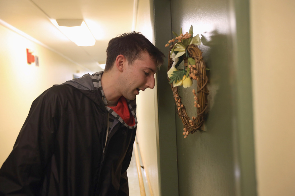 Democratic party volunteer Matt Lattanzi worked door to door for the Obama campaign while canvassing in a Youngstown, Ohio, apartment building on Oct. 28.