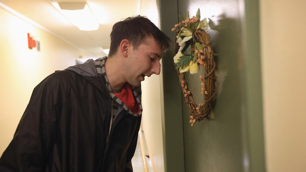 Democratic party volunteer Matt Lattanzi worked door to door for the Obama campaign while canvassing in a Youngstown, Ohio, apartment building on Oct. 28. (Getty Images)