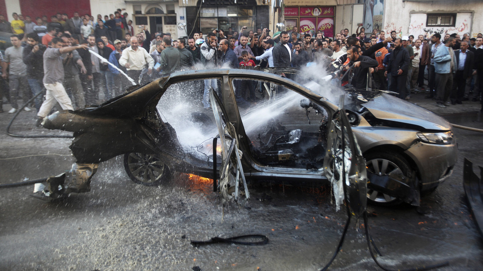 A car hit by one of today's airstrikes in Gaza City. (Reuters /Landov)