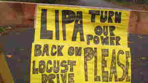 A plea to the Long Island Power Authority for electricity to be restored is posted on a barrier in Mastic Beach, N.Y. on Oct. 31, 2012. The south shore Long Island community was among the hardest hit by the storm that pounded the Northeast.