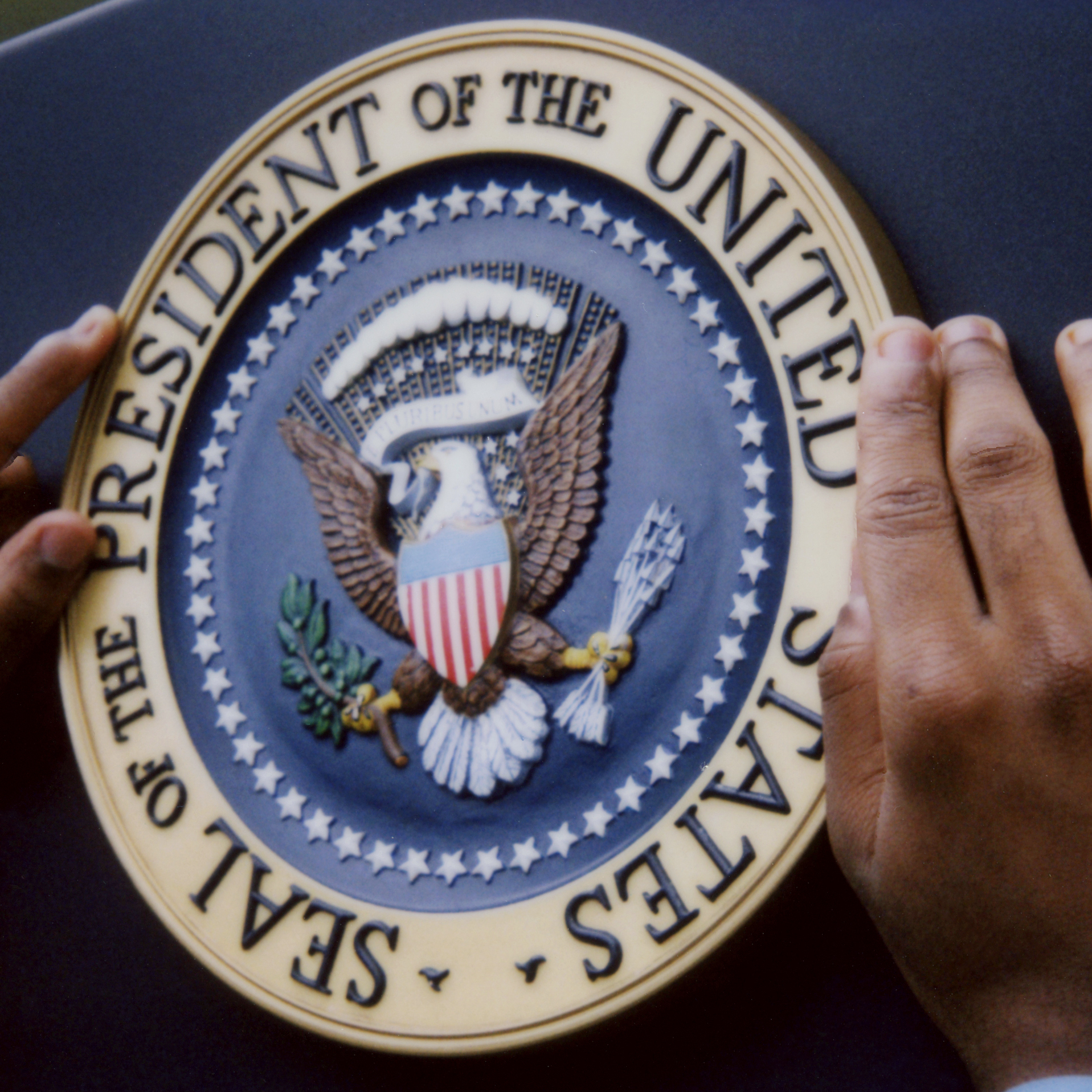 When a president stands at a podium, the presidential seal is right there.
