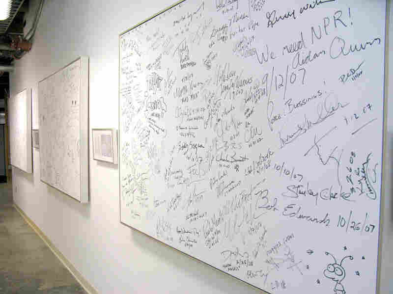 """The """"Signature Wall,"""" where interview guests and notable NPR West visitors passing through leave notes... and the occasional doodle."""