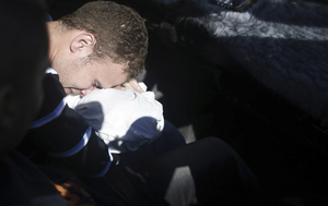 Jihad Masharawi, a Palestinian employee of BBC Arabic in Gaza, mourns over the body of his 11-month-old son.