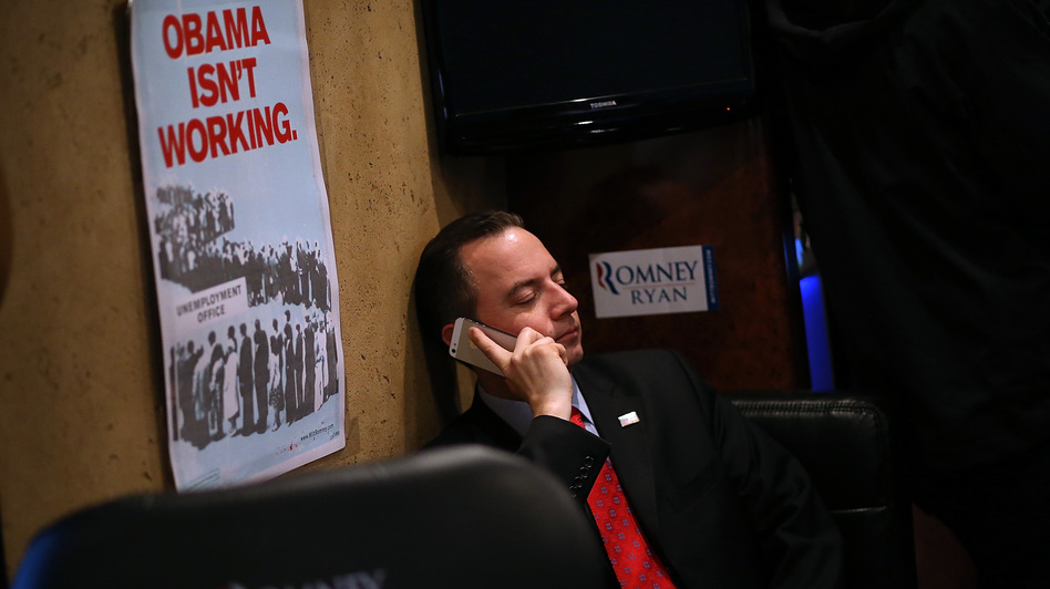 Republican National Committee Chairman Reince Priebus rides the Mitt Romney campaign bus days before the presidential election. Despite Romney's loss and other GOP failures, Priebus, who helped the party raise huge sums of money in 2012, may seek a second term. (Getty Images)