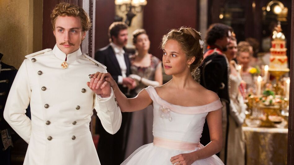 The as-yet-unmarried Kitty (Alicia Vikander) harbors a naive passion for Vronsky (Aaron Taylor-Johnson), who has his eyes on a less suitable prize. (Focus Features)