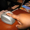 A pilot program in Mississippi requires low-income parents who receive subsidized child care to submit to biometric finger scans like this one, at Northtown Child Development Center in Jackson. Some parents and day care workers say the rule is unnecessary and discriminatory, but state officials say it will save money and prevent fraud.