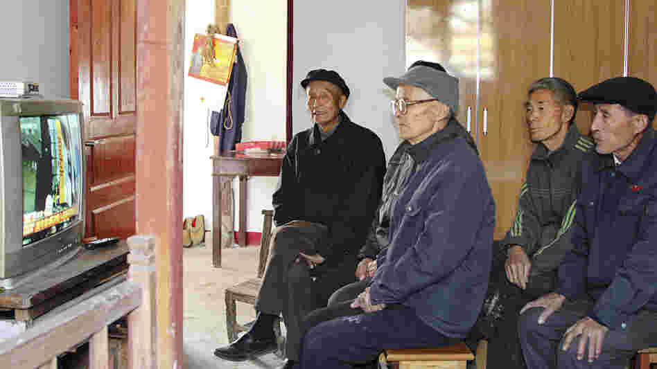 Villagers in Dongjiangai, in eastern China's Jiangsu province, watch the presentation of the Communist Party's new leadership on national TV Thursday. They say they support the new leaders because of the improvements government policies have brought to their village.